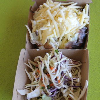 The Baked Potato Stand is a crowd favorite at both. The Show threw in some cole slaw with the potato.